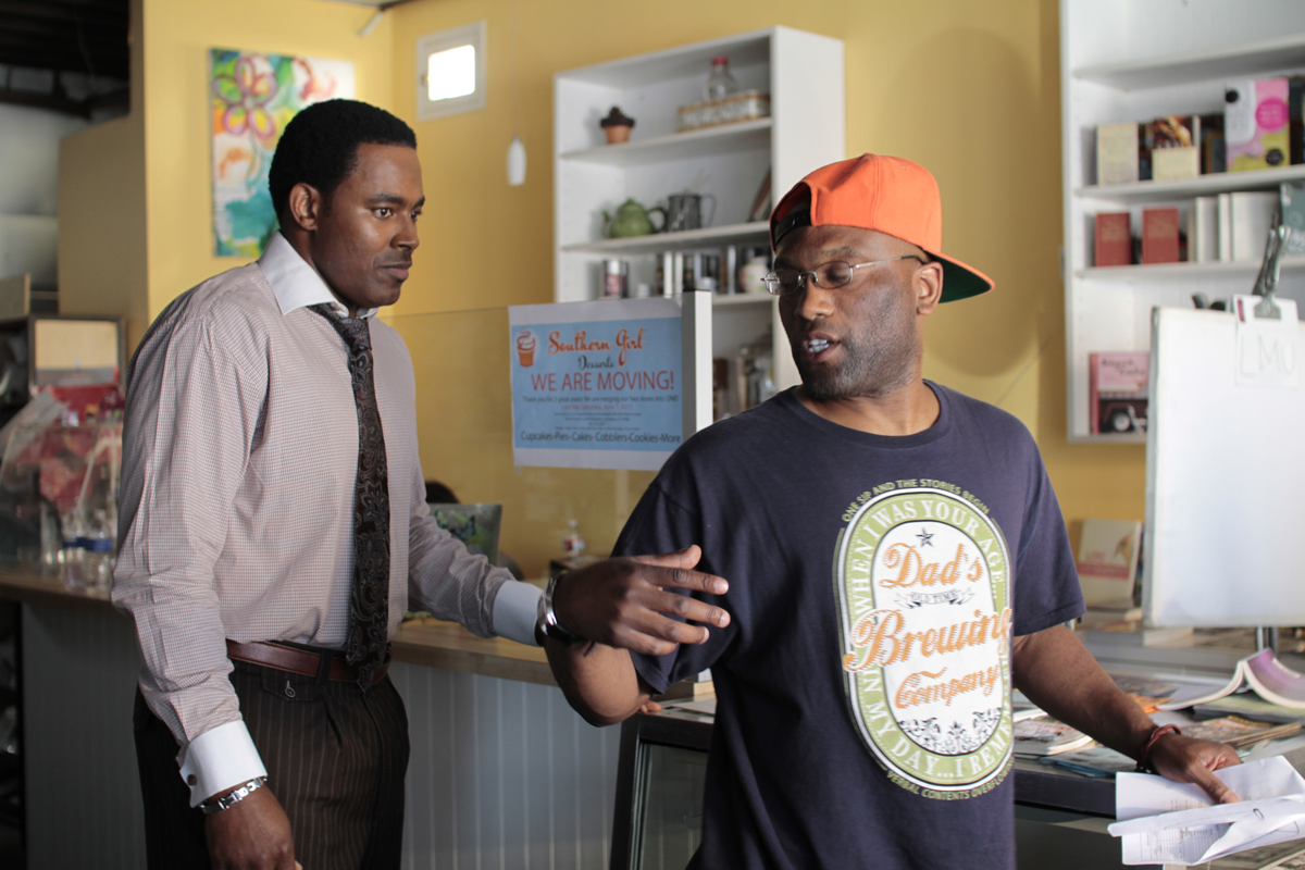 """Director Mark Harris, right, on the set of """"Black Coffee."""""""