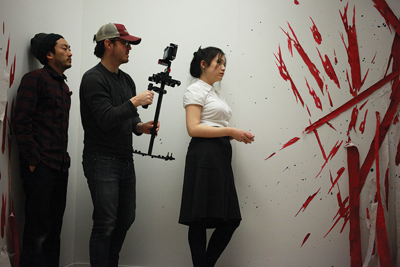 "Director Eugene Park, cinematographer Tracy Pitts, and lead actor Wanda Jin in production for ""Self-Deportation: The Untold Tale of a Marginal Woman."" Courtesy Conner Keeffe."