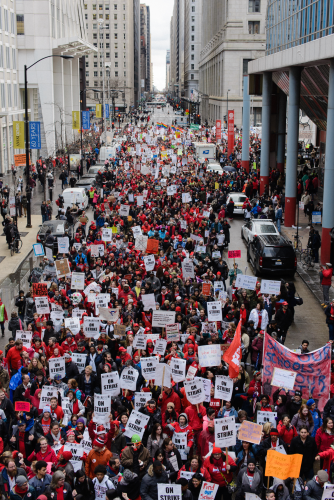 Thousands of protesters joined an hour-long march that traveled down Michigan Avenue and Lake Shore Drive, Luke White
