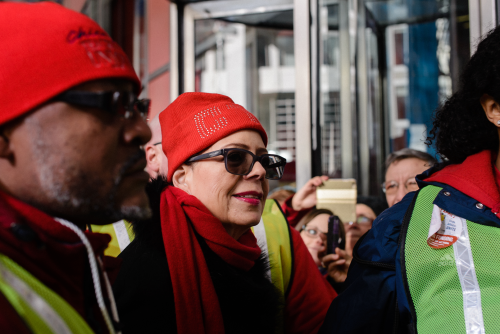 Union marshals escorted CTU President Karen Lewis away from the rally stage after her speech, Luke White