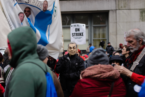 A man in a Rahm Emanuel mask said he wore the mask to protest the mayor's 2013 school closings; other protestors marched to demand more investment in neighborhood public schools, Luke White