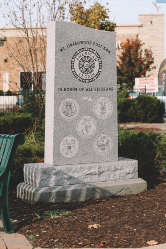 "A monument near Mt. Greenwood Plaza stands ""in honor of all veterans"" of the military. The neighborhood, which was the only one in Chicago to vote for Donald Trump in the presidential election, is home to many police officers and firefighters"