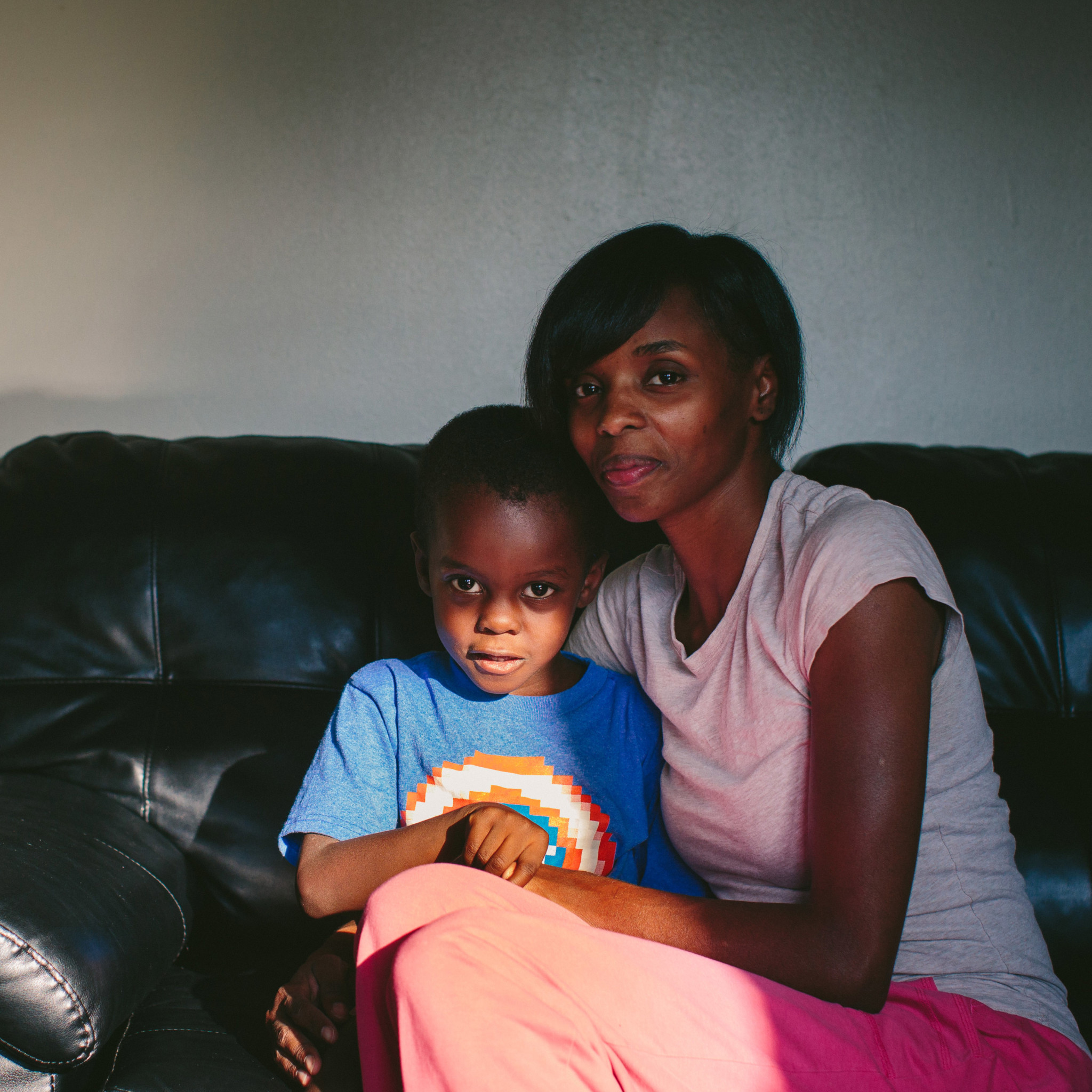 "Stephanie King embraces her youngest son, Josiah King, 3, whose blood lead levels test results were above the CDC's 5 mg/d threshold for action. Two and a half years ago, King left Chicago's South Side to find a safer environment for her four sons and one daughter. ""If I''d have known the dirt had lead, he wouldn''t have been out there playing in it,"" King said."