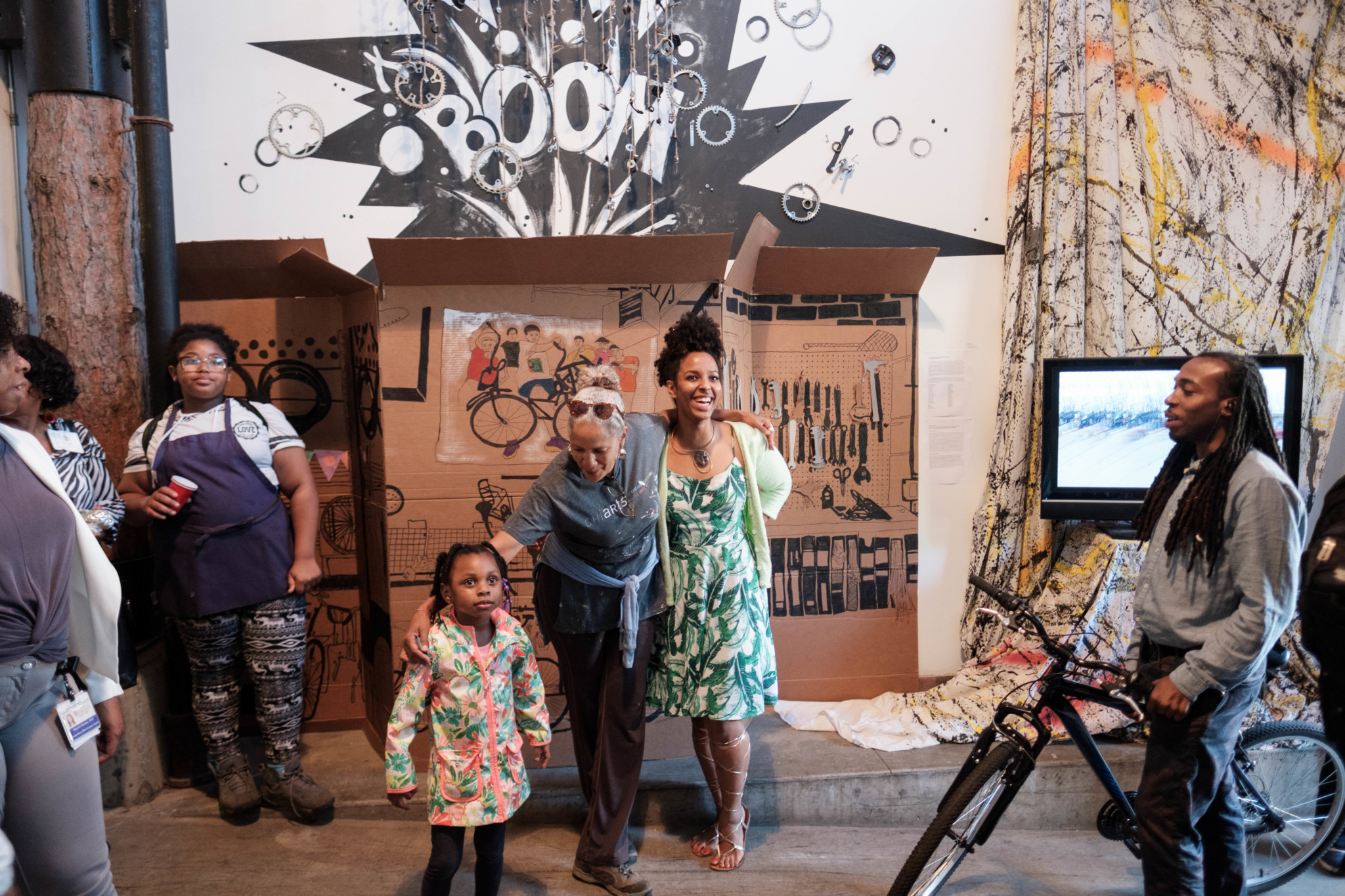 "Dorian Sylvain and Tita Thomas stand by their installation, ""exploding bike shop,"" made in collaboration with Blackstone Bicycle youth, Dorian's students from the Hyde Park Art Center, and volunteers from South Side in Focus (J. Michael Eugenio)"