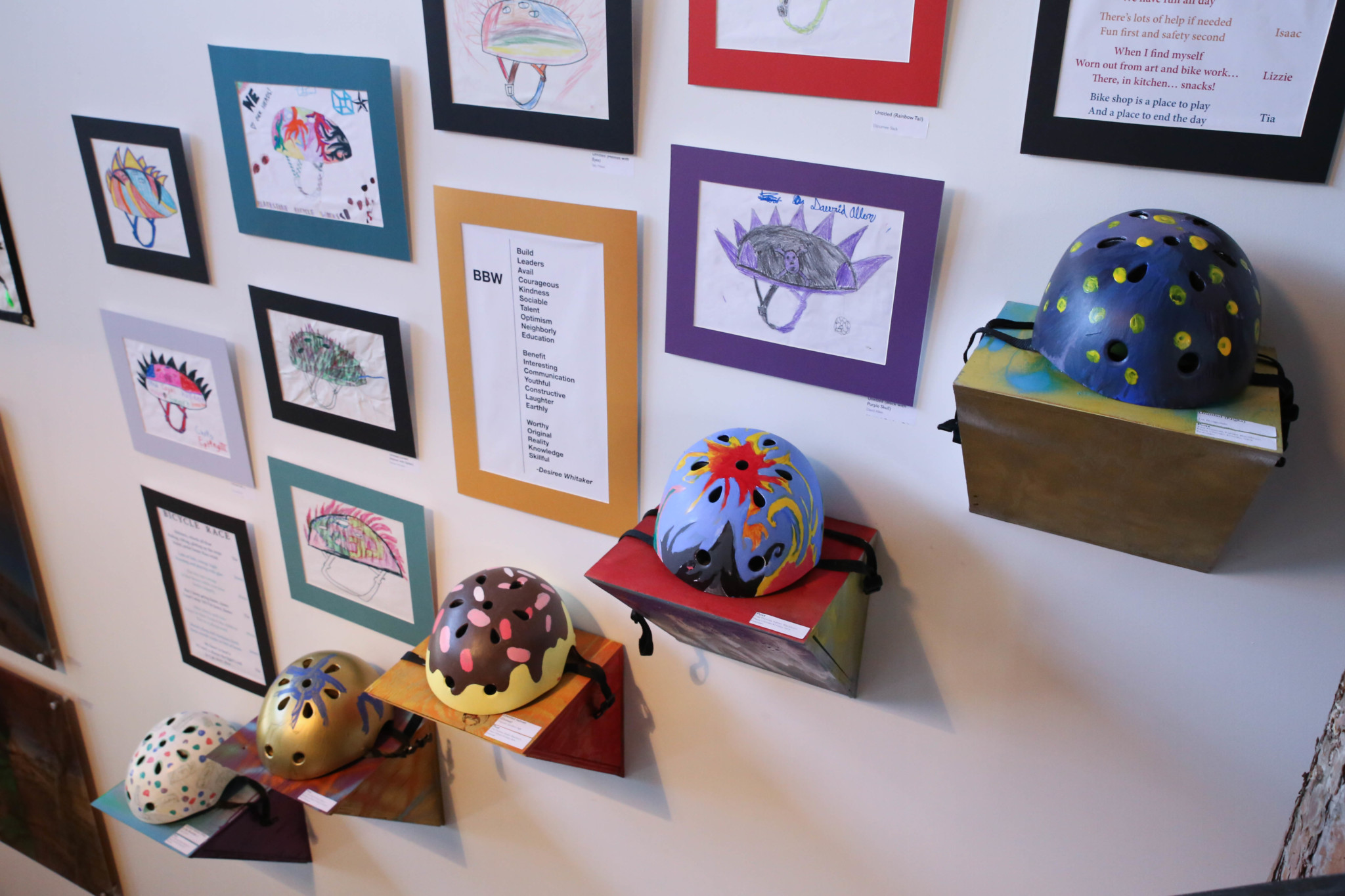 """Helmets of the future"" exhibit made by Blackstone Bicycle Works youth members in collaboration with resident artist Tita Thomas (Jason Schumer)"