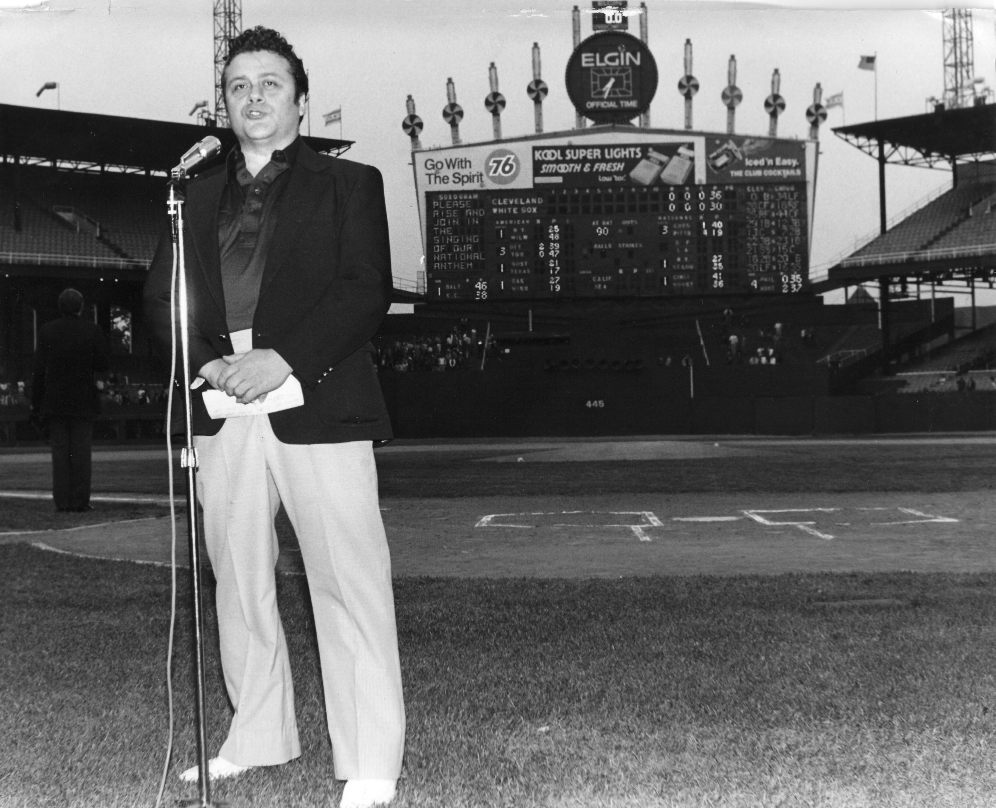 Johnny O sings the National Anthem to open a White Sox game at then-Comiskey Park, circa 1978 (Courtesy Johnny O's)