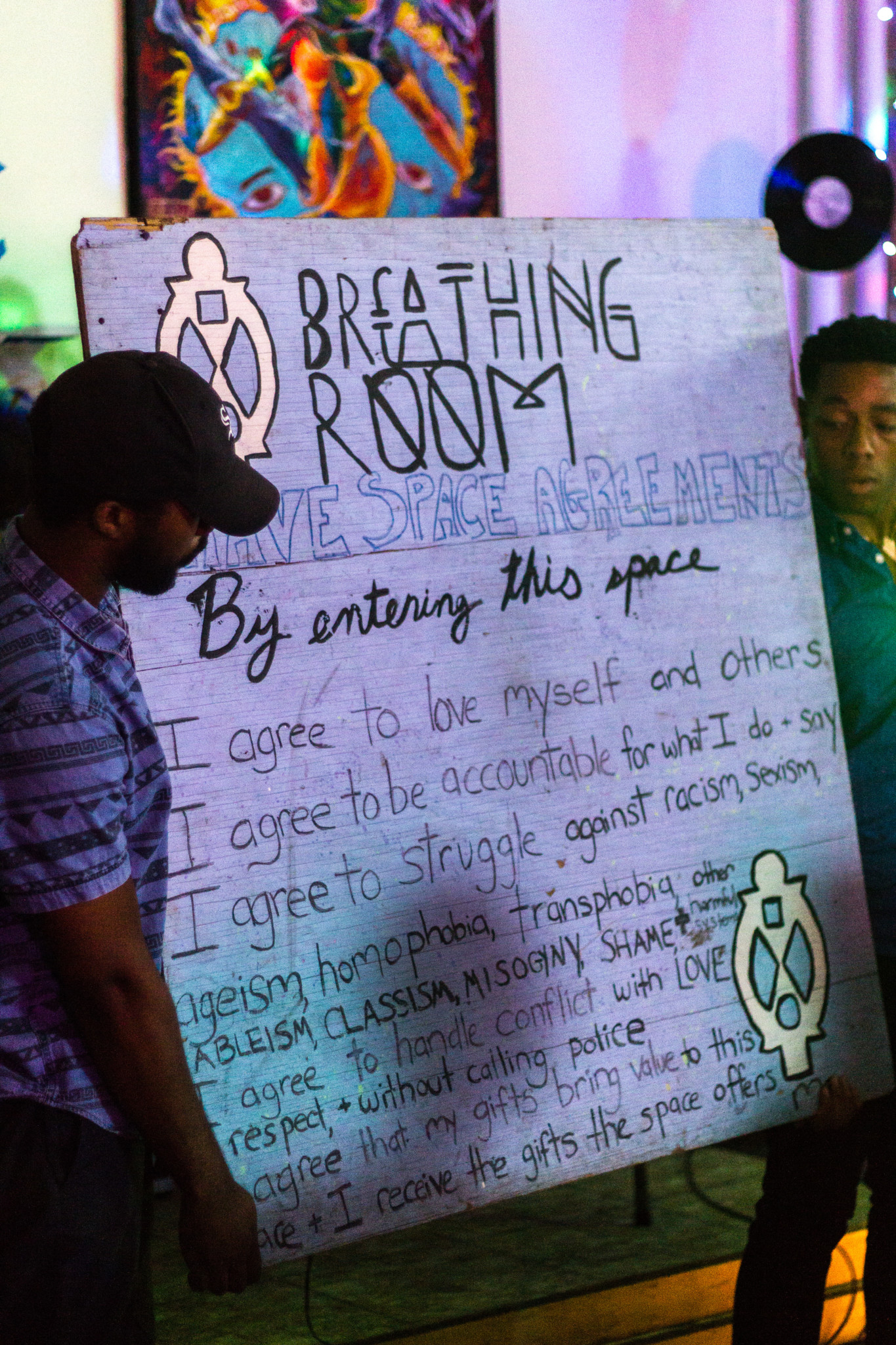 Before the open mic starts, organizers of the #BreathingRoom read the space agreements to create a safe space for all in attendance.