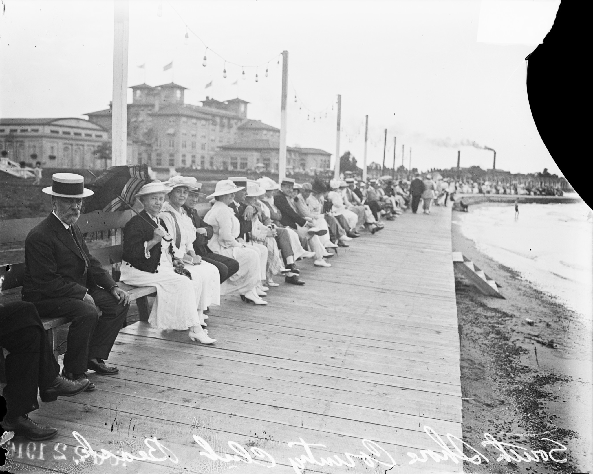 People sitting on a bench along the South Shore Country Club boardwalk at 7059 South Shore Drive, in the South Shore community, Chicago, Illinois, circa August 22, 1916. (Courtesy Chicago History Museum, Chicago Daily News negatives collection)