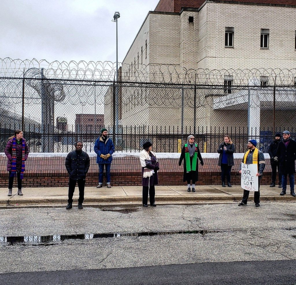 Faith leaders hold a vigil in solidarity with incarcerated people on March 23. Photo by: Coalition to End Money Bond