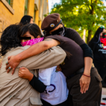 Protesters embraced following the violence. Photo by Óscar Sánchez.