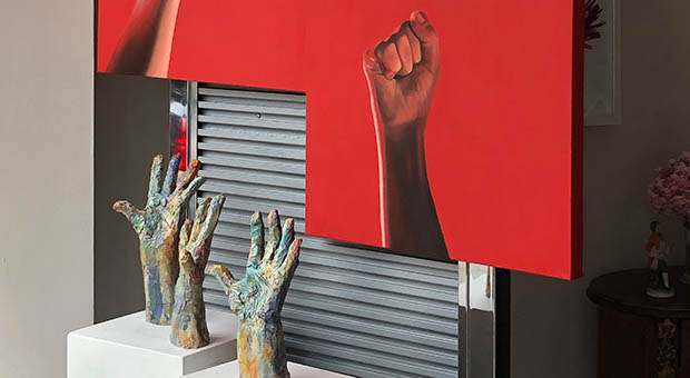 """Pandemograms_""""Arise"""" paintings by T.C. English-Dumont, """"Open Hands"""" ceramic sculptures by Robin Power. Photo: Courtesy of Beverly Area Arts Alliance"""