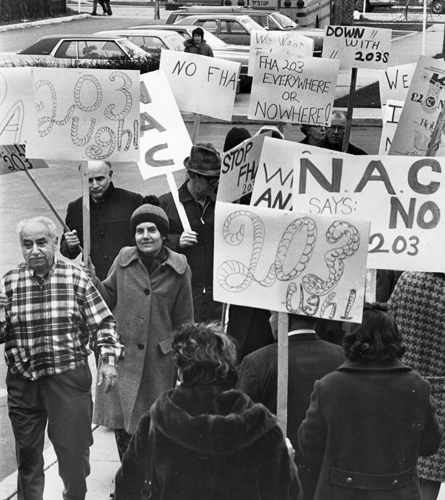 - A Chicago protest against abuse of the Federal Housing Administration Section 203 insurance program. After Redlining. Courtesy of People's Action.