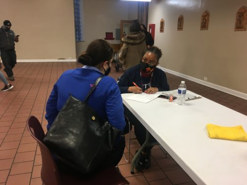 """Community health promoters known as """"Promotoras"""" signed up Spanish speakers for appointments in Little Village as part of the Protect Chicago Plus initiative. Photo Credit: Alma Campos"""