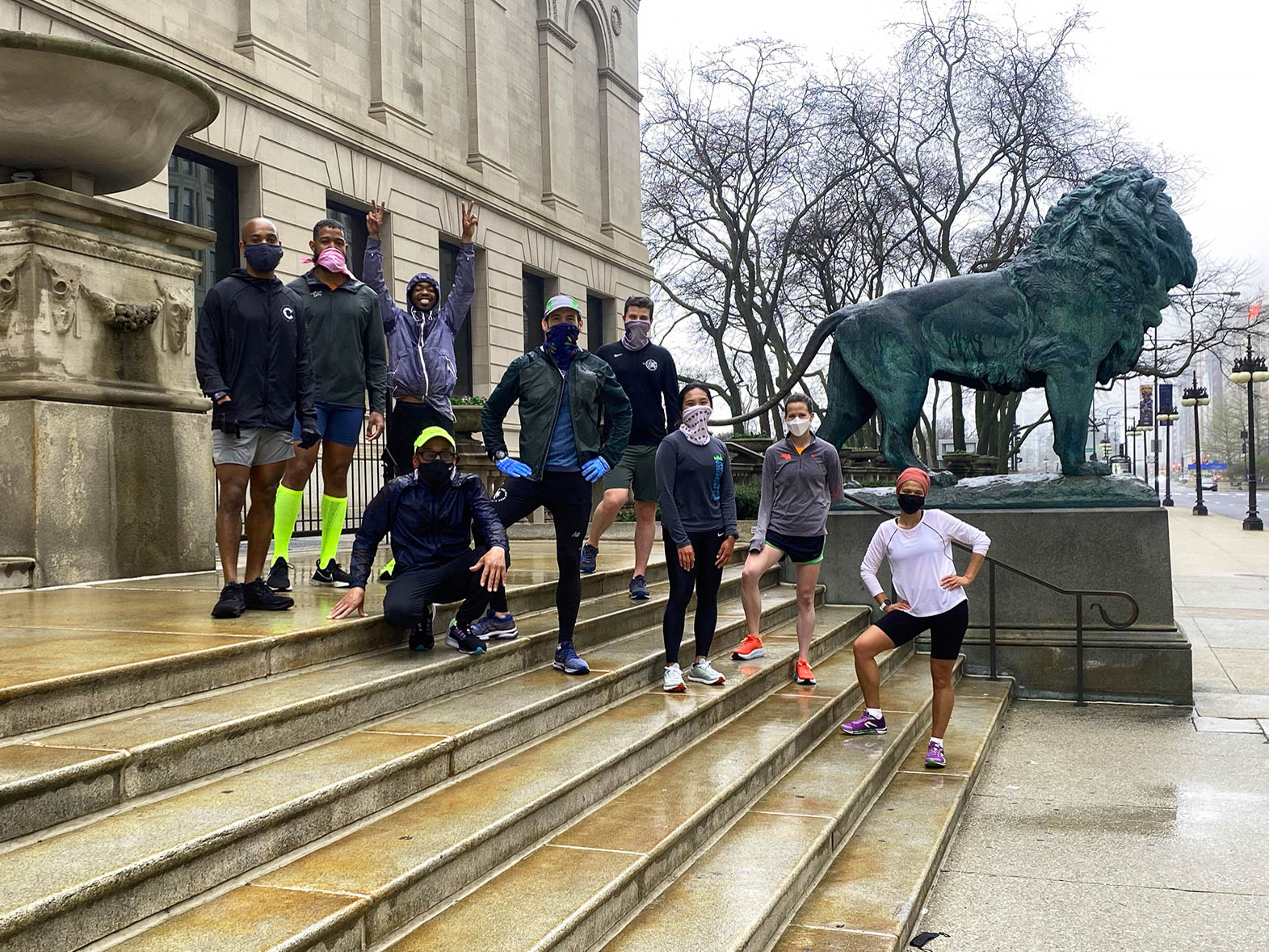 Black and brown runners posing outside the Art Institute in downtown Chicago