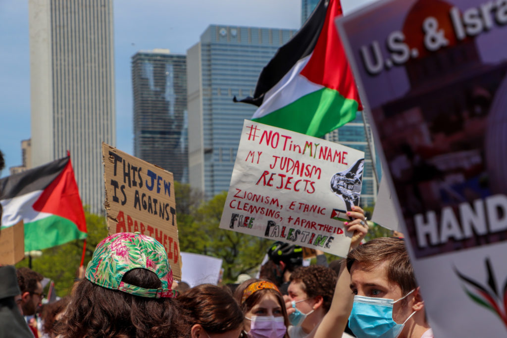 Members of IfNotNow Chicago, a Jewish-American organization, hold signs in support of Palestinian liberation on May 16, 2021 in Chicago. (Madison Muller/South Side Weekly)