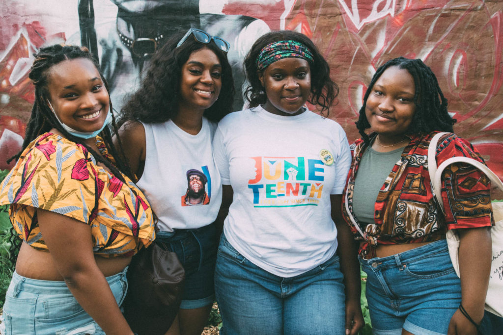 HERChicago team, including Alyson Godbolt, Imari Wilson, and Jorie Beacon, posing for a photo at the Breathing Room's Juneteenth event